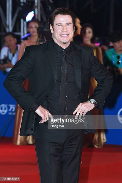 Actor John Travolta attends the red carpet show for the Qingdao Oriental Movie Metropolis on September 22 2013 in Qingdao China