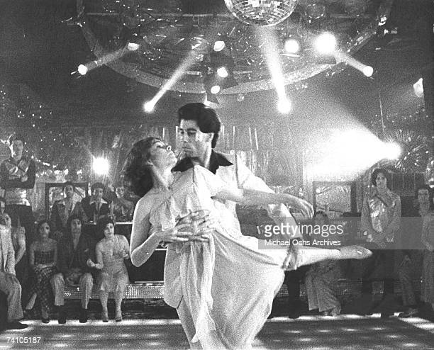 Actor John Travolta dances with Karen Lynn Gorney in scene from movie Saturday Night Fever directed by John Badham