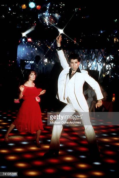 Actor John Travolta dances with Karen Lynn Gorney in scene from movie 'Saturday Night Fever' directed by John Badham
