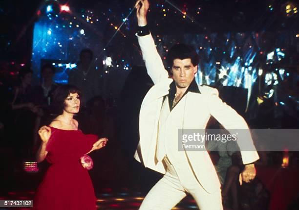 Actor John Travolta dancing with actress Karen Gorney in the movie 'Saturday Night Fever'