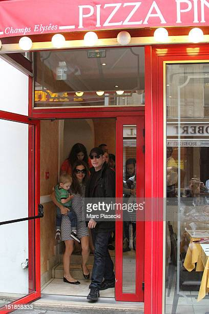 Actor John Travolta his wife Kelly Preston and their son Benjamin are seen leaving the 'Pizza Pino' restaurant on September 12 2012 in Paris France