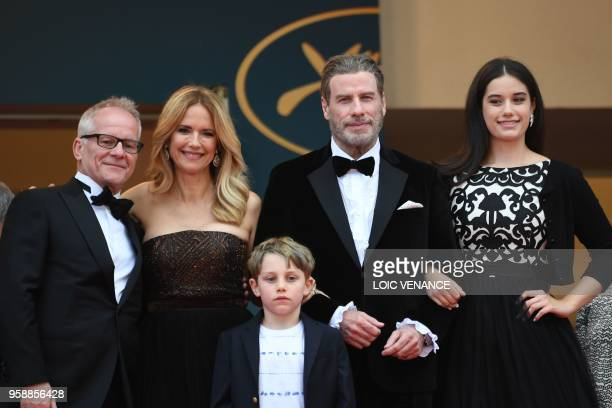 US actor John Travolta his wife US actress Kelly Preston and children Ella Bleu Travolta and Benjamin Travolta pose with the General Delegate of the...