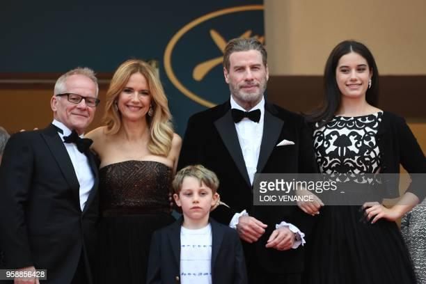 Actor John Travolta , his wife US actress Kelly Preston and children Ella Bleu Travolta and Benjamin Travolta pose with the General Delegate of the...