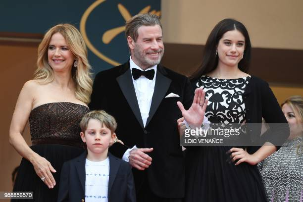 US actor John Travolta his wife US actress Kelly Preston and their children Ella Bleu Travolta and Benjamin Travolta pose as they arrive on May 15...