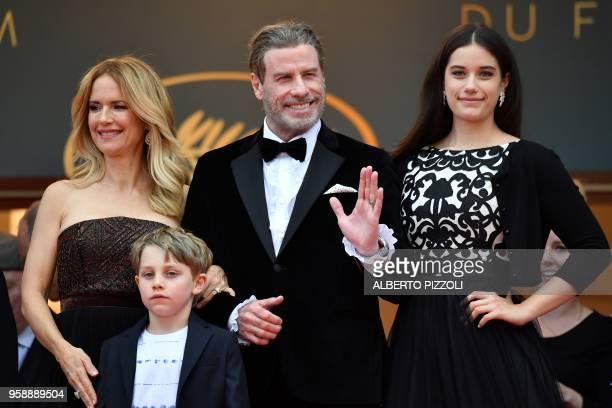 US actor John Travolta his wife US actress Kelly Preston and their children Ella Bleu Travolta and Benjamin Travolta pose as they arrive on May 15...
