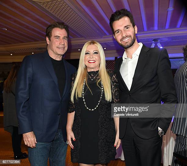 Actor John Travolta Lady Monika Bacardi and producer Andrea Iervolino of AMBI Group Grand Gala in Rome for Puerto Azul Resort and Andrea Iervolino's...