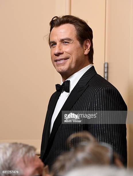 Actor John Travolta of 'The People v OJ Simpson American Crime Story' winner of Best Miniseries or Television Film walks into the press room during...