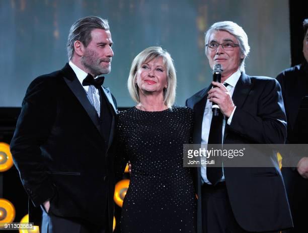 Actor John Travolta Olivia Newton John and John Farrar speak onstage during the 2018 G'Day USA Black Tie Gala at InterContinental Los Angeles...