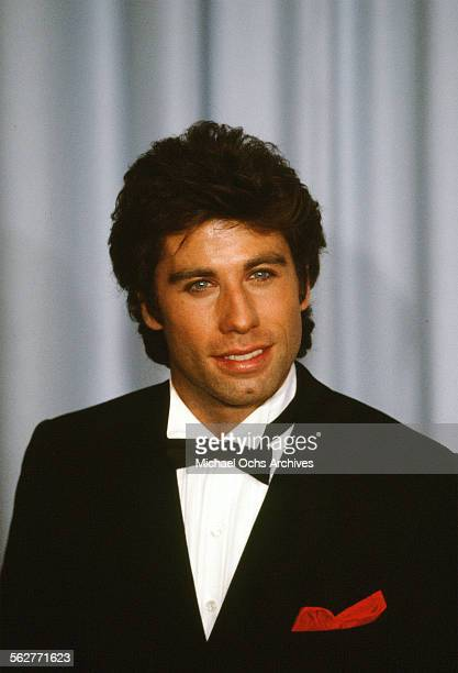 Actor John Travolta pose backstage during the 55th Academy Awards at Dorothy Chandler Pavilion Los Angeles California
