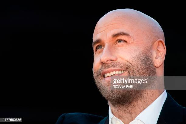 Actor John Travolta poses as he arrives for a tribute screening on October 22, 2019 during the 14th Rome Film Festival at the Auditorium Parco della...