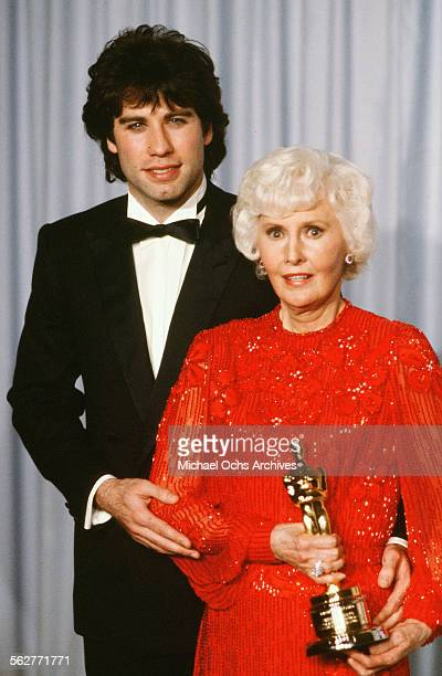 Actor John Travolta poses backstage with Barbara Stanwyck winner of the Honorary Academy Award during the 54th Academy Awards at Dorothy Chandler...