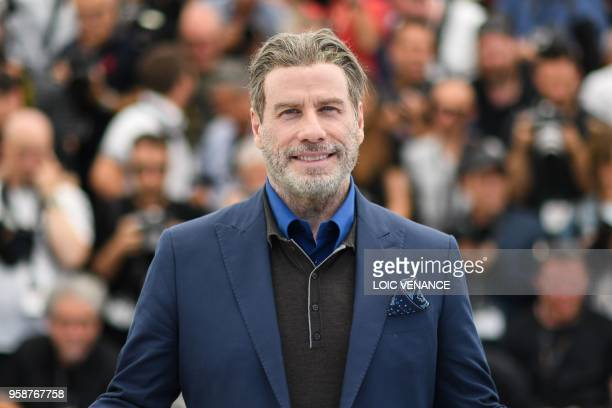 US actor John Travolta poses on May 15 2018 during a photocall for the film Gotti at the 71st edition of the Cannes Film Festival in Cannes southern...