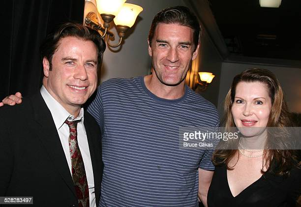 Actor John Travolta poses with actor Patrick Boll, and playwright Myra Bairstow when he visits The Rise of Dorothy Hale Off-Broadway at St. Lukes...