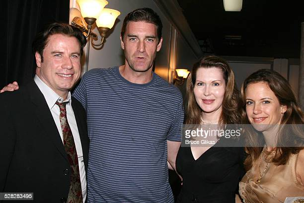 Actor John Travolta poses with actor Patrick Boll, playwright Myra Bairstow and Kelly Preston when he visits The Rise of Dorothy Hale Off-Broadway at...