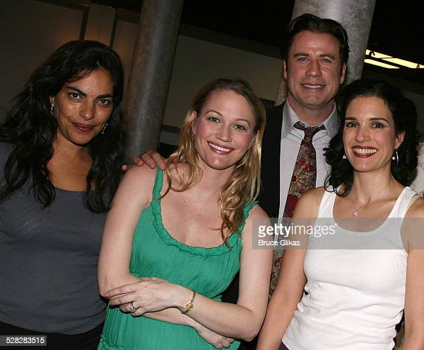 Actor John Travolta poses with Sarita Choudhury, Sarah Wynter and Laura Koffman when he visits The Rise of Dorothy Hale Off-Broadway at St. Lukes...