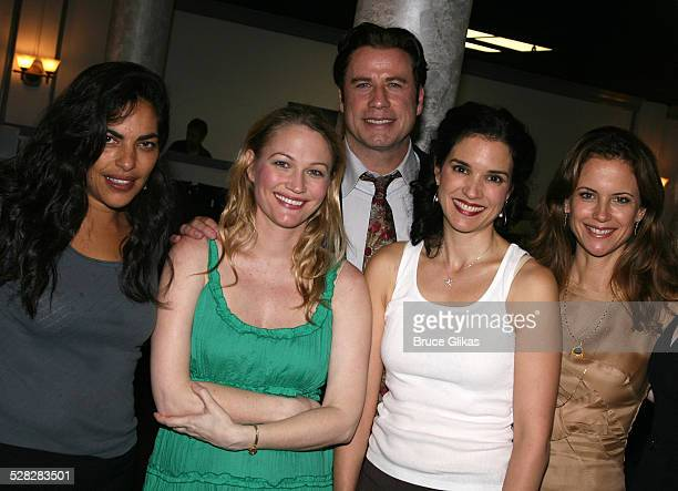 Actor John Travolta poses with Sarita Choudhury, Sarah Wynter, Laura Koffman and Kelly Preston when he visits The Rise of Dorothy Hale Off-Broadway...