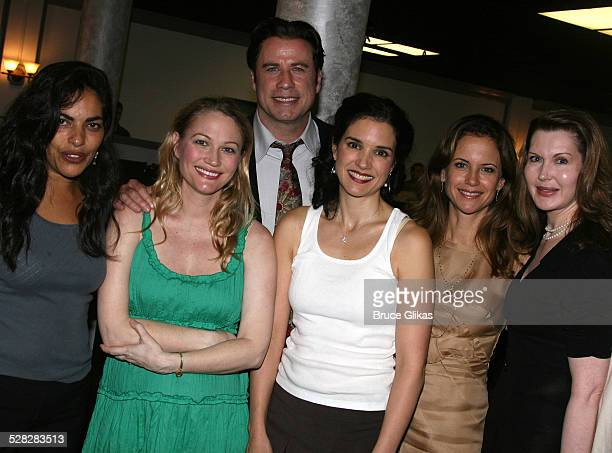 Actor John Travolta poses with Sarita Choudhury, Sarah Wynter, Laura Koffman, Kelly Preston and playwright Myra Bairstow when he visits The Rise of...