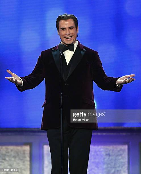 Actor John Travolta presents an award during the 22nd Annual Critics' Choice Awards at Barker Hangar on December 11 2016 in Santa Monica California