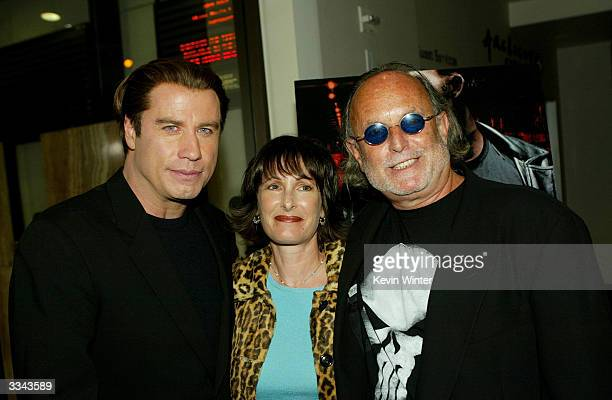 Actor John Travolta producer Gale Anne Hurd and producer Avi Arad attends the Los Angeles premiere of the Lion's Gate film 'The Punisher' at the...