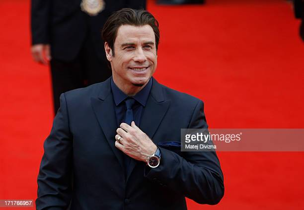 Actor John Travolta reacts as he arrives at the opening ceremony of the 48th Karlovy Vary International Film Festival on June 28, 2013 in Karlovy...