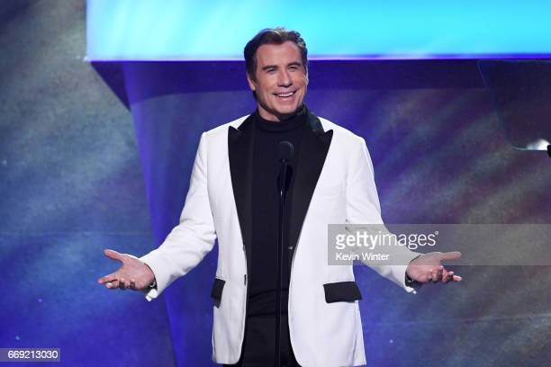 Actor John Travolta speaks onstage during 'Stayin' Alive A GRAMMY Salute To The Music Of The Bee Gees' on February 14 2017 in Los Angeles California