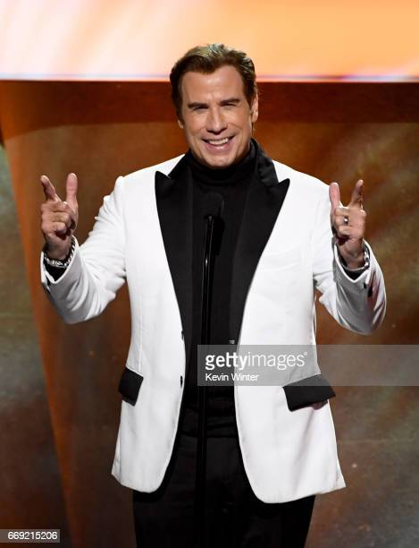 Actor John Travolta speaks onstage during Stayin' Alive A GRAMMY Salute To The Music Of The Bee Gees on February 14 2017 in Los Angeles California