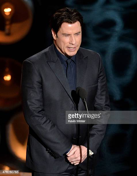 Actor John Travolta speaks onstage during the Oscars at the Dolby Theatre on March 2 2014 in Hollywood California