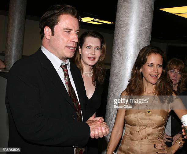 Actor John Travolta talks to the cast with playwright Myra Bairstow and Kelly Preston when he visits The Rise of Dorothy Hale Off-Broadway at St....