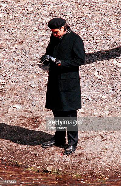 Actor John Travolta test fires his gun during the filming his new movie Swordfish in this undated photo taken in February 2001 in Medford OR Travolta...