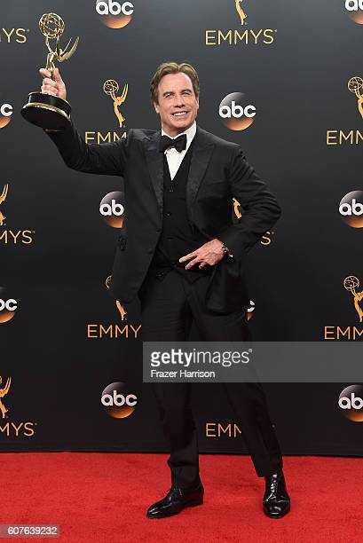 """Actor John Travolta winner of Best MiniSeries or Movie for """"The People v O J Simpson American Crime Story"""" poses in the press room during the 68th..."""