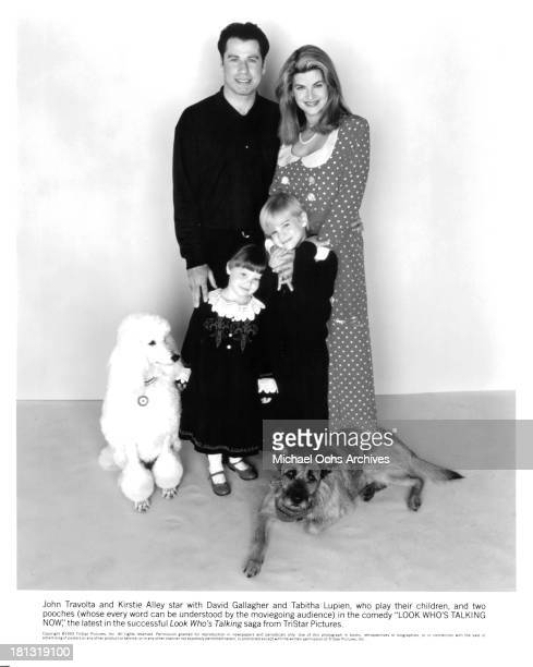 Actor John Travolta with actress Kirstie Alley with David Gallagher and Tabitha Lupien pose for the Tri Star movie Look Who's Talking Now in 1993
