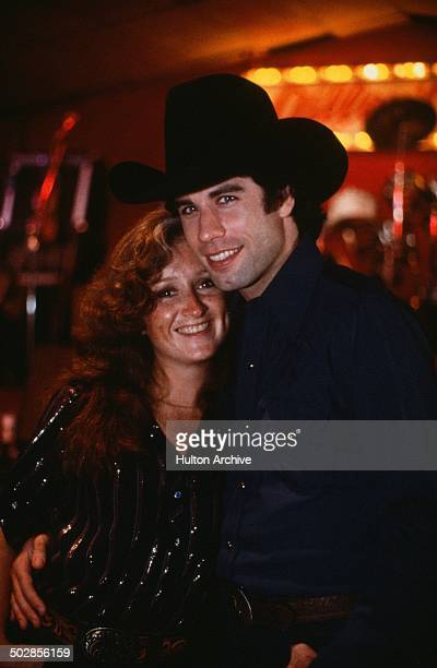 Actor John Travolta with Bonnie Raitt on set during the Paramount Pictures movie 'Urban Cowboy circa 1980