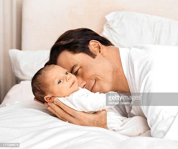 Actor John Travolta with his newborn son Benjamin Travolta at home in Florida on January 4 2011