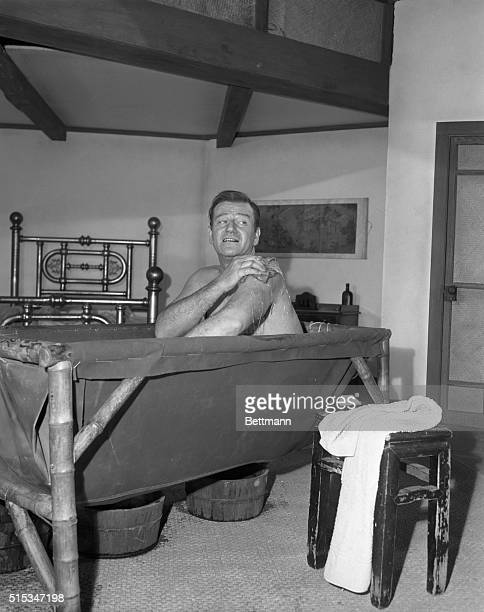 Actor John Wayne stole the show from Hollywood glamor girls with a bathtub scene part of the goings on in his new film 'Blood Alley' There were to be...