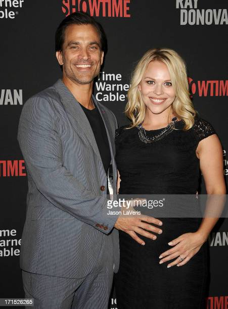 Actor Johnathon Schaech and Julie Solomon attend the series premiere of 'Ray Donovan' at the DGA Theater on June 25 2013 in Los Angeles California