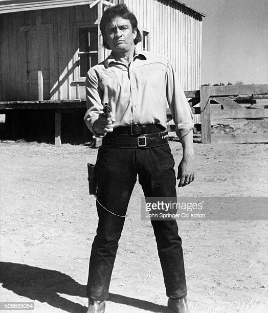 Actor Johnny Cash plays Abe Cross in the 1971 film A Gunfight