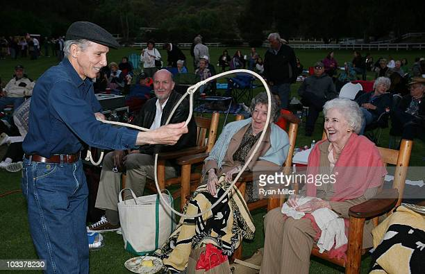 Actor Johnny Crawford does a rope trick for Will's costars from Mr Skitch 87year old twins Cleora Robb and Glorea Robb during the Grand Opening and...