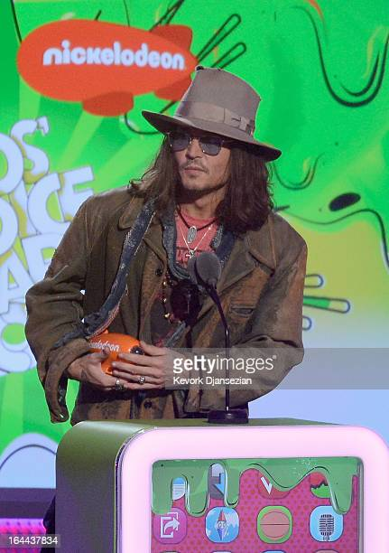 Actor Johnny Depp accepts Favorite Movie Actor award for Dark Shadows onstage during Nickelodeon's 26th Annual Kids' Choice Awards at USC Galen...