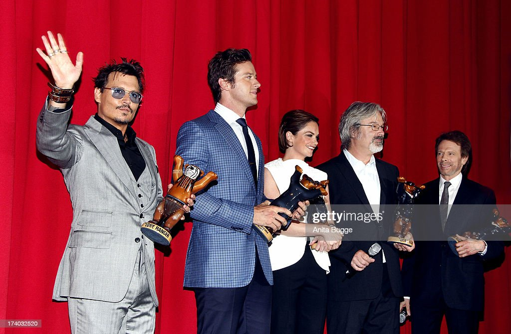 Actor Johnny Depp, actor Armie Hammer, actress Ruth Wilson, director Gore Verbinski and producer Jerry Bruckheimer receive a 'Lone Ranger Berlin Bear' during the 'Lone Ranger' Germany premiere at Sony Centre on July 19, 2013 in Berlin, Germany.