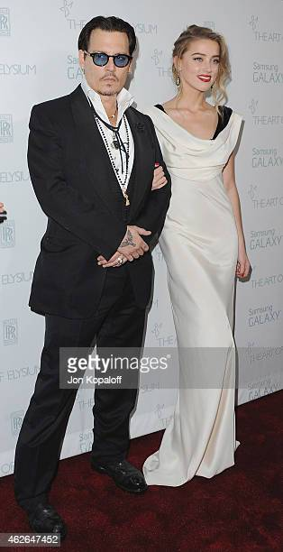 Actor Johnny Depp and actress Amber Heard arrive at The Art Of Elysium 8th Annual Heaven Gala at Hangar 8 on January 10, 2015 in Santa Monica,...