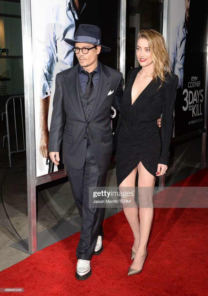 Actor Johnny Depp and actress Amber Heard arrive at the premiere of '3 Days to Kill' at ArcLight Cinemas on February 12, 2014 in Hollywood, California.