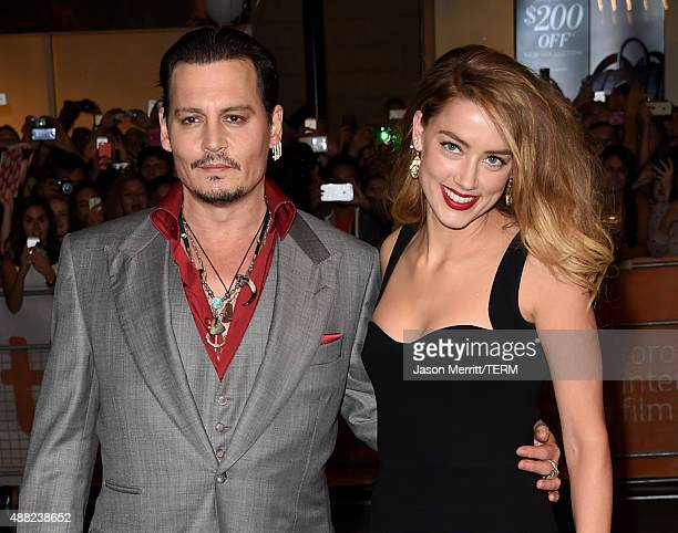 Actor Johnny Depp and Actress Amber Heard attend the Black Mass premiere during the 2015 Toronto International Film Festival at The Elgin on...