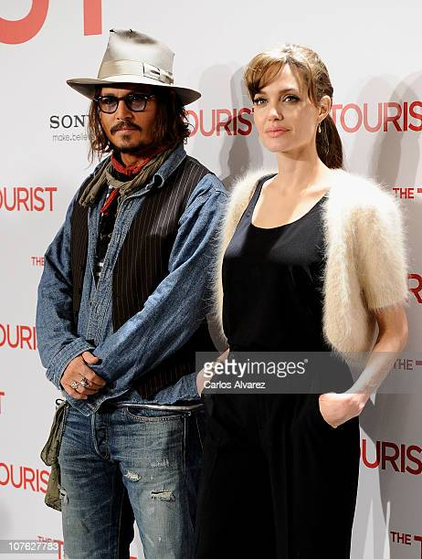 """Actor Johnny Depp and actress Angelina Jolie attend """"The Tourist"""" photocall at Villamagna Hotel on December 16, 2010 in Madrid, Spain."""