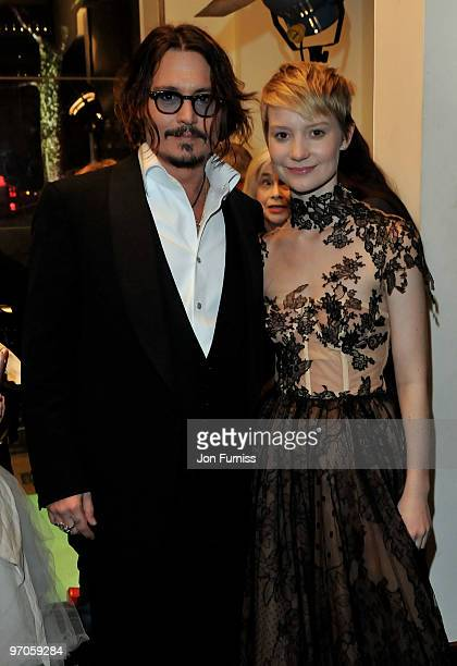Actor Johnny Depp and actress Mia Wasikowska attend the Royal World Premiere of Tim Burton's 'Alice In Wonderland' at the Odeon Leicester Square on...