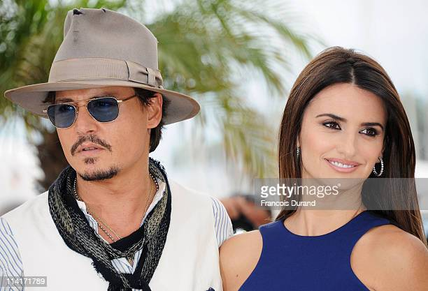 """Actor Johnny Depp and actress Penelope Cruz attend the """"Pirates of the Caribbean: On Stranger Tides"""" photocall at the Palais des Festivals during the..."""