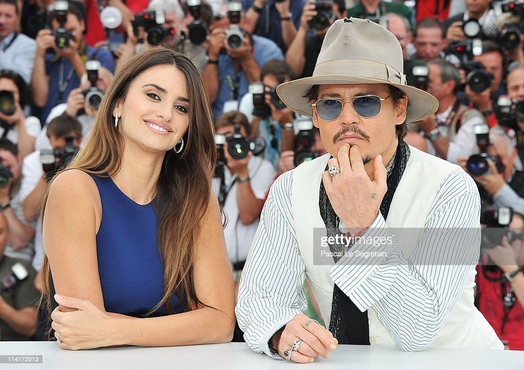 Actor Johnny Depp (R) and actress Penelope Cruz attend the 'Pirates of the Caribbean: On Stranger Tides' photocall at the Palais des Festivals during the 64th Cannes Film Festival on May 14, 2011 in Cannes, France.