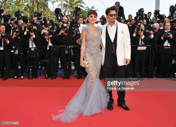 """Actor Johnny Depp and actress Penelope Cruz attend the """"Pirates of the Caribbean: On Stranger Tides"""" premiere at the Palais des Festivals during the..."""
