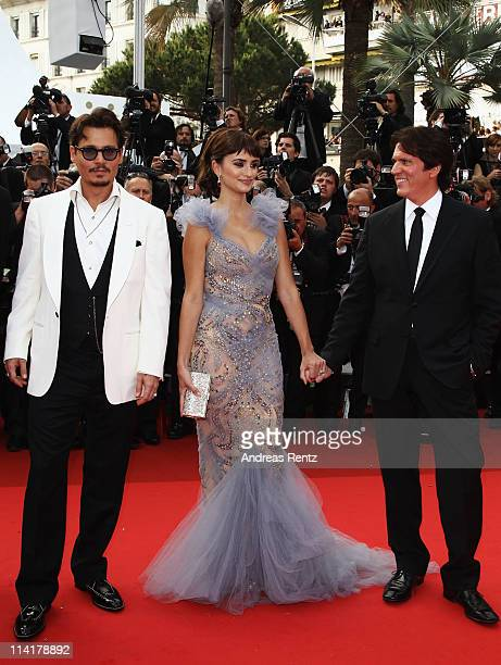 Actor Johnny Depp and actress Penelope Cruz with director Rob Marshall attend the 'Pirates of the Caribbean On Stranger Tides' premiere at the Palais...
