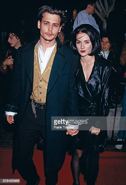 Actor Johnny Depp and actress Winona Ryder arrive at the premiere of Edward Scissorhands This photo appears on page 89 in Frank Trapper's RED CARPET...