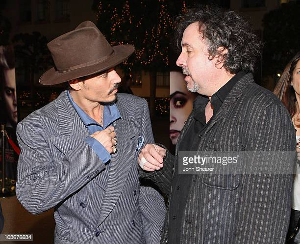 """Actor Johnny Depp and director Tim Burton arrive at the special screening of DreamWorks Pictures' """"Sweeney Todd"""" at the Paramount Theater on December..."""